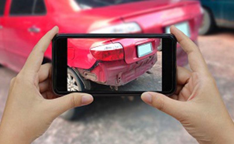 hand-holding-smart-phone-take-a-photo-at-the-scene-of-a-car-crash_t20_doWpA9SRFGERSG
