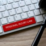 selective-focus-of-gavel-and-computer-keyboard-with-red-key-written-with-personal-injury-law-on-a_t20_kL28OraF