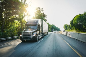 freight-transportation-and-logistics-semi-truck-18-wheeler-on-the-highway-at-sunset_t20_VLQxAwssc